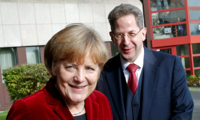German Chancellor Angela Merkel and Hans-Georg Maassen, the President of the Federal Office for the Protection of the Constitution, Germany's domestic security agency in Cologne, Germany on Oct. 31, 2014. (Reuters/Wolfgang Rattay/File Photo)
