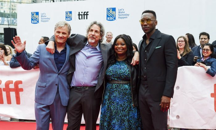 """Actors Viggo Mortensen, left to right, director Peter Farrelly, Octavia Spencer and Mahershala Ali pose on the red carpet before the screening of """"Green Book"""" during the Toronto International Film Festival in Toronto, on Tuesday, Sept. 11, 2018. (Christopher Katsarov/The Canadian Press via AP)"""