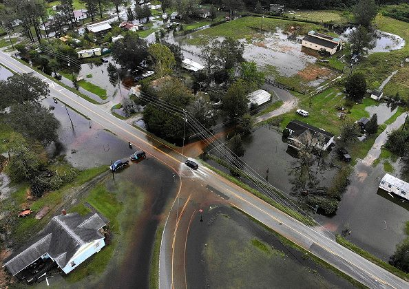 A car drives down a flooded road, on Sept. 16, 2018 in Leland, North Carolina. (Mark Wilson/Getty Images)
