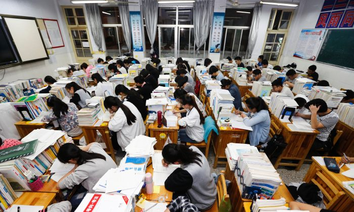 Senior high school students studying at night to prepare for the college entrance exams at a high school in Lianyungang, east China's Jiangsu province, on May 24, 2016.  (STR/AFP/Getty Images)