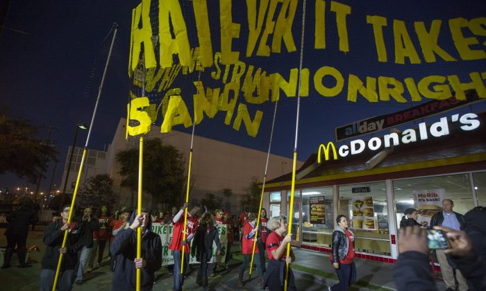 McDonald's restaurant employees rally after walking off the job to demand a $15 per hour wage and union rights in Los Angeles on Nov. 29, 2016. (David McNew/Getty Images)