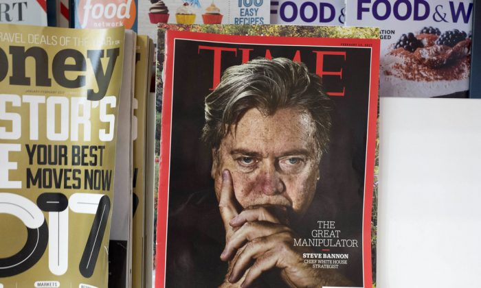 An issue of Time magazine is displayed on a New York newsstand. Time Magazine is being sold by Meredith Corp. to Marc Benioff, a co-founder of Salesforce, and his wife. Nov. 16, 2017. (AP Photo/Mark Lennihan, File)