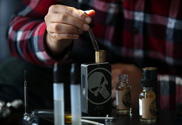 A customer fills a vaporizer, or E-Cigarette, with oil at Digital Ciggz in San Rafael, California on Jan. 28, 2015. (Justin Sullivan/Getty Images)