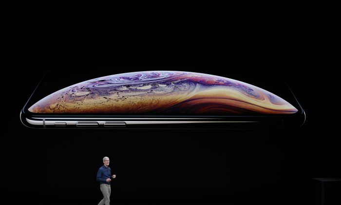 Tim Cook, CEO of Apple, speaks about the iPhone XS and XS Max at an Apple Inc product launch event at the Steve Jobs Theater in Cupertino, California, on Sept. 12, 2018. (Reuters/Stephen Lam).