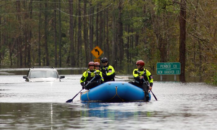 A search and rescue task force patrols a flooded region by boat over a fully submerged road in the aftermath of Hurricane Florence in Castle Hayne, North Carolina, U.S., September 17, 2018. (By Jonathan Drake/Reuters)