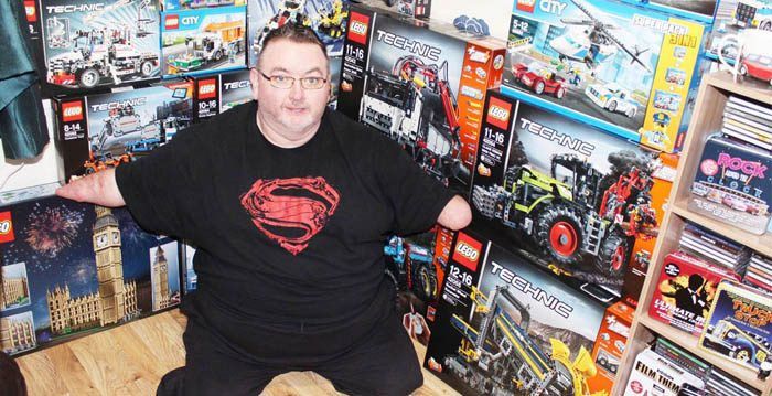 DJ Calvert in front of his impressive collection of Lego sets (Courtesy of Desmond James Calvert)