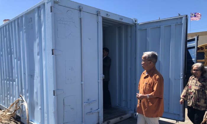 Visitors look at an in-progress shipping container with showers in Garden Grove, Calif. on Sept. 16, 2018. (Annie Wang/Epoch Times)