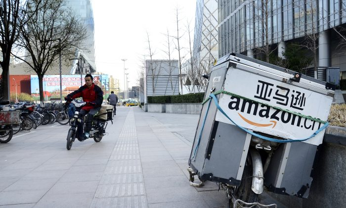 An electric bike (R) used by Amazon sits parked along the pavement at a central business district in Beijing on November 29, 2012. (WANG ZHAO/AFP/Getty Images)