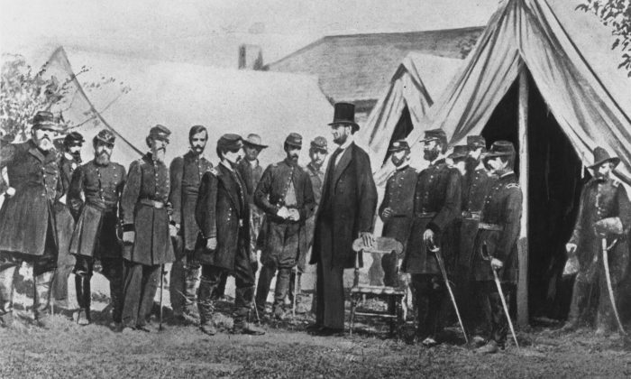 President Abraham Lincoln visits soldiers encamped at the Civil War battlefield of Antietam in Maryland on Oct. 1, 1862. (Rischgitz/Getty Images)