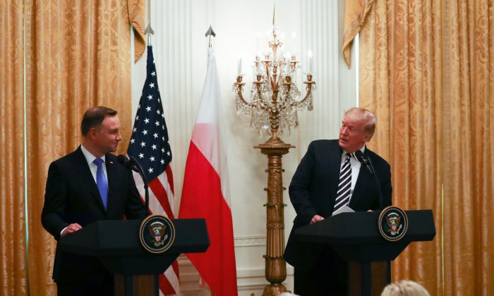President Donald Trump holds a joint press conference with the Polish President Andrzej Duda in the East Room of the White House in Washington on Sept. 18, 2018. (Charlotte Cuthbertson/The Epoch Times)