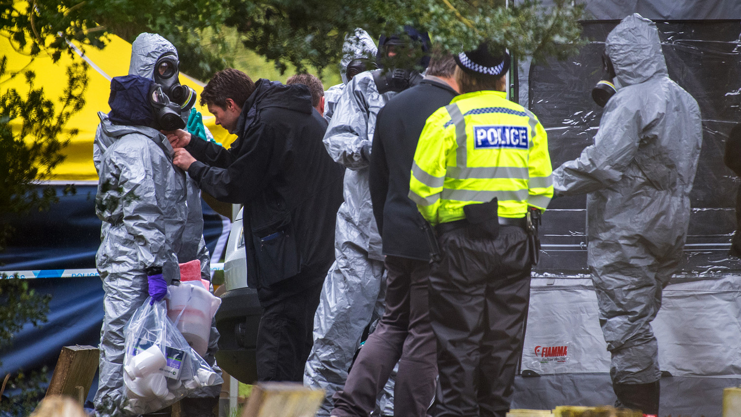 Police officers wear protective suits and breathing apparatus in London Road cemetery as they continue investigations into the poisoning of Sergei Skripal who was found critically ill on a bench in Salisbury on March 10, 2018 in Salisbury, England. (Chris J Ratcliffe/Getty Images)