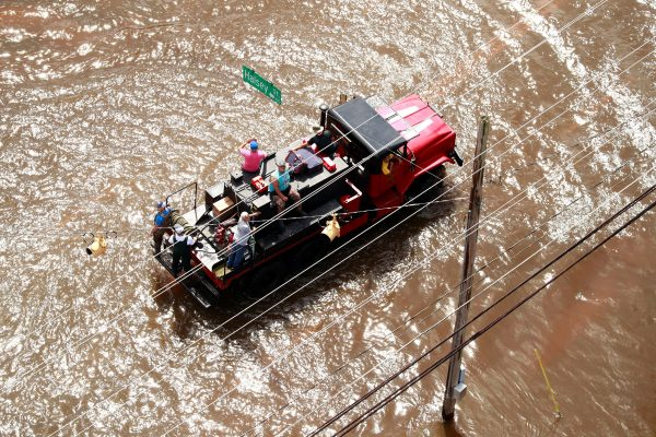 People gather on a truck in floodwater