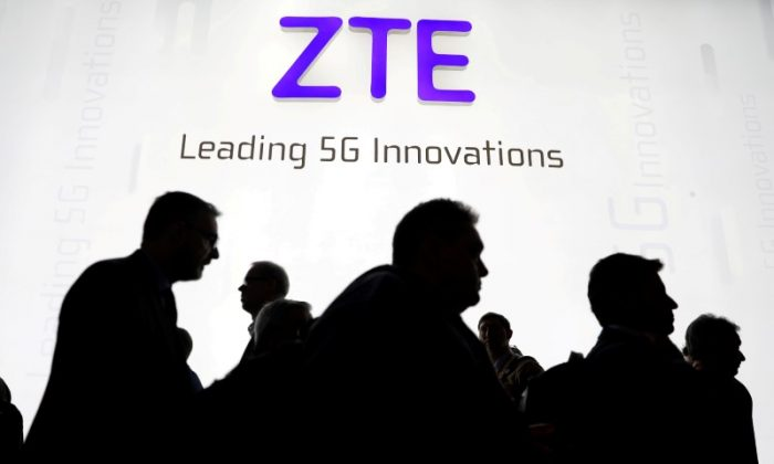 Visitors pass in front of the ZTE Corp booth at the Mobile World Congress in Barcelona, Spain on February 26, 2018. (Sergio Perez/Reuters)