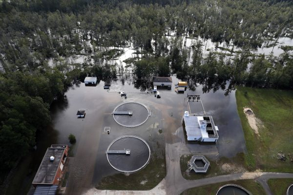 A waste treatment facility inundated with floodwater