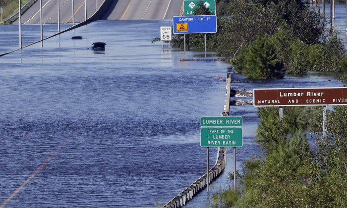 The Lumber River overflows onto a stretch Interstate 95 in Lumberton, N.C., on Sept. 18, 2018. (Gerry Broome/AP Photo)