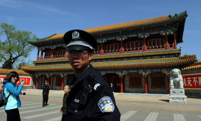 A Chinese policeman stands guard outside Zhongnanhai, the central headquarters of the Chinese Communist Party and living quarters for the top CCP officials, in Beijing in a file photo. (Mark Ralston/AFP/Getty Images)