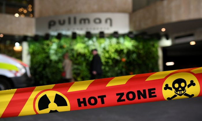 Emergency service workers at the scene of a chemical leak at the Pullman Hotel in Sydney, Australia on Sept. 19, 2018. (AAP/Joel Carrett/Reuters)