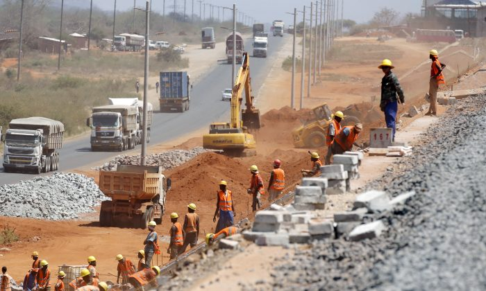 Construction workers work on a railway line near Voi town, Kenya on March 16, 2016. (Goran Tomasevic/Reuters)