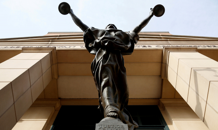 The statue of Lady Justice stands at the Federal Courthouse in Alexandria, Virginia, on Aug.17, 2018.      (Reuters/Joshua Roberts)