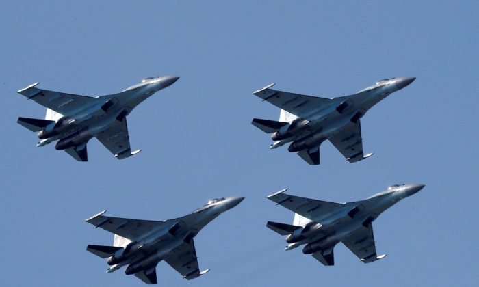 Sukhoi Su-35 multi-role fighters of the Sokoly Rossii (Falcons of Russia) aerobatic team fly in formation during a demonstration flight at the MAKS 2017 air show in Zhukovsky, outside Moscow, Russia, July 21, 2017. (Reuters/Sergei Karpukhin)