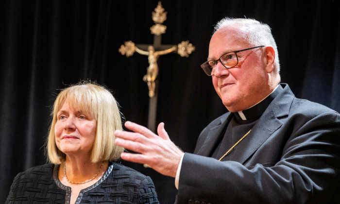 Former judge in the U.S District Court for the Southern District of New York Barbara S. Jone and  Archbishop of New York Cardinal Timothy Dolan speak during a news conference in Manhattan, New York Sept. 20, 2018.  (Reuters/Jeenah Moon)
