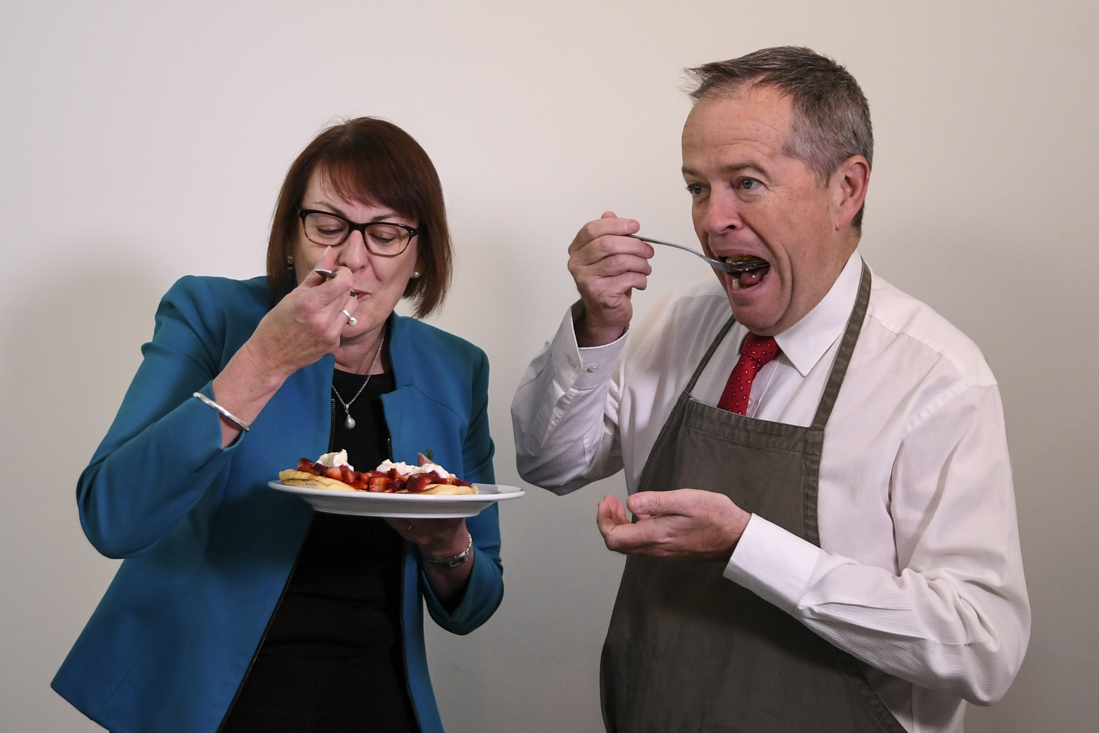 Australian Opposition Leader Bill Shorten and Labor MP Susan Templeman eat strawberry pancakes in Canberra