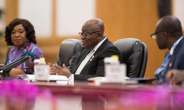 Ghana's President Nana Akufo-Addo (C) speaks to Chinese leader Xi Jinping (not pictured) during their meeting at the Great Hall of the People in Beijing on Sept. 1, 2018. (Nicolas Asfouri/AFP/Getty Images)