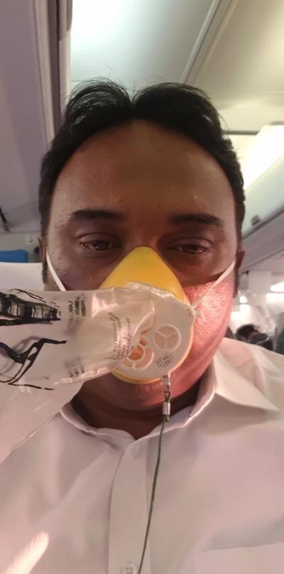 Jet Airways passenger wears an oxygen mask