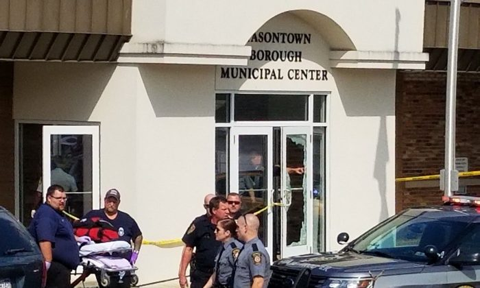 Law enforcement and emergency personnel gather outside the office of District Judge Daniel Shimshock's office in Masontown, Pa., on Sept. 19, 2018. (Mike Jones/Washington/AP)
