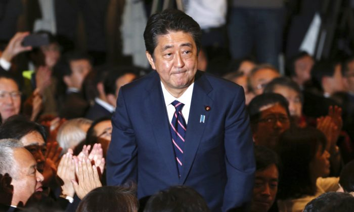 Liberal Democratic Party President Shinzo Abe receives applause from the LDP lawmakers shortly after his name was called as the winner of the ruling party presidential elections at its headquarters in Tokyo, on Sept. 20, 2018. (Koji Sasahara/AP)