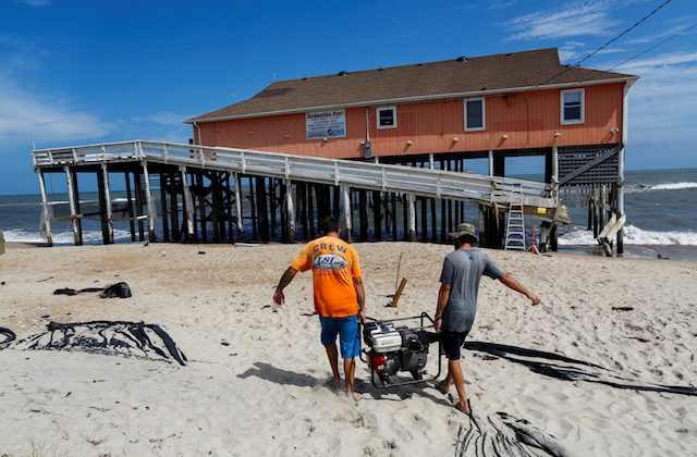 People work in the reconstruction of Rodanthe pier after being partially damaged after the pass of Hurricane Florence, on Sept. 18, 2018. (Reuters/Eduardo Munoz)