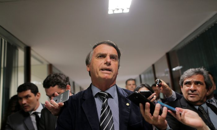 Presidential candidate Jair Bolsonaro speaks with journalists at the National Congress in Brasilia, Brazil, on Sept. 4, 2018. (Adriano Machado/Reuters)