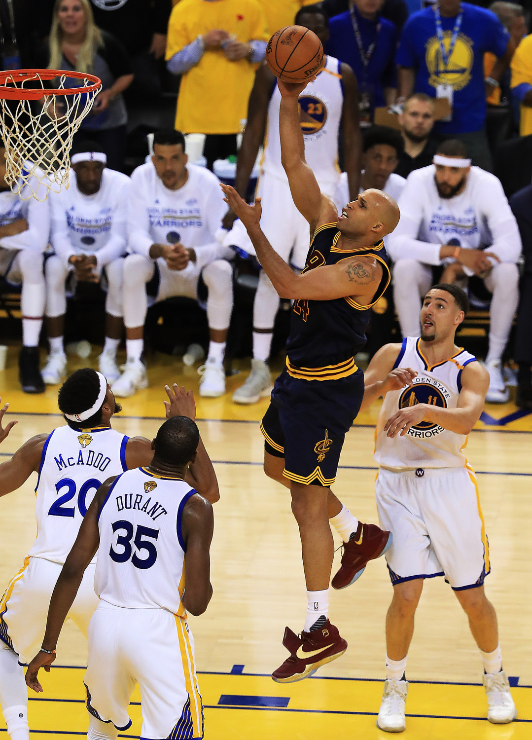 Richard Jefferson attempts to score against the Warriors