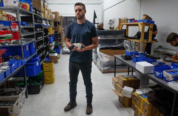 Cody Wilson holds printed gun