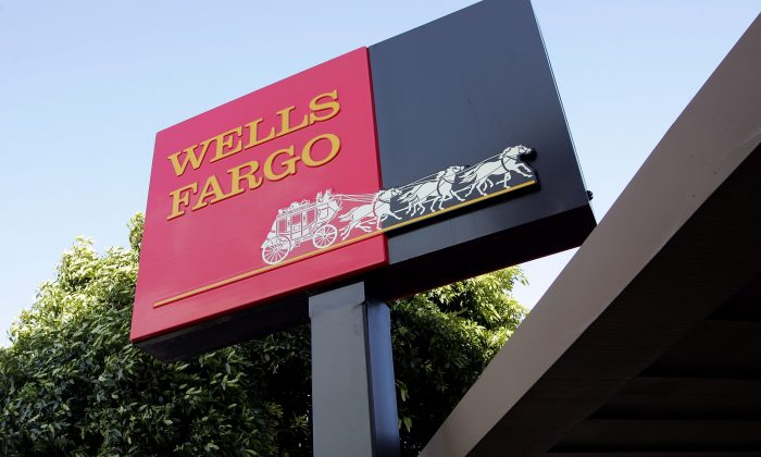 The Wells Fargo logo is seen on a sign outside of a Wells Fargo Home Mortgage branch office in a file photo. (Justin Sullivan/Getty Images)