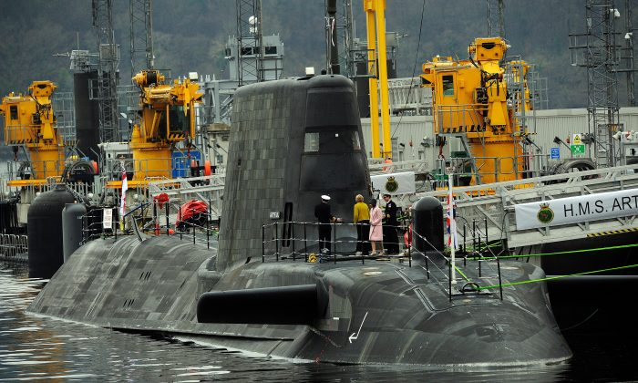 Dignitaries board a British nuclear submarine at Faslane Naval Base in Scotland on March 18, 2016. (Andy Buchanan/AFP/Getty Images)