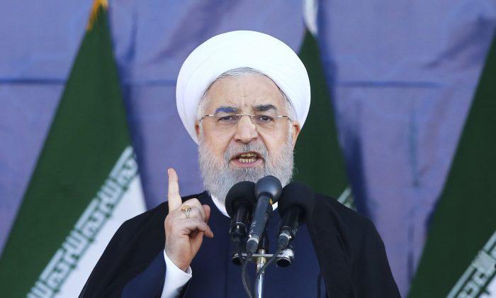 Iran's President Hassan Rouhani speaks at a military parade in a file photograph. (Ebrahim Noroozi/AP Photo)