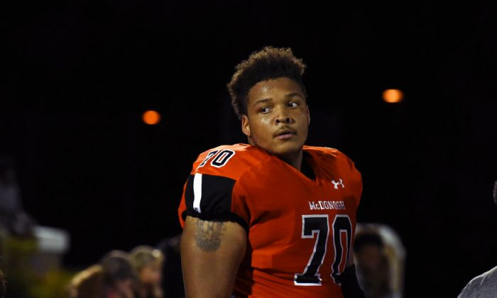 McDonogh high school football lineman Jordan McNair watches from the sideline during a game in McDonogh, Md. on Sept. 16, 2016. (Barbara Haddock Taylor/The Baltimore Sun via AP, File)