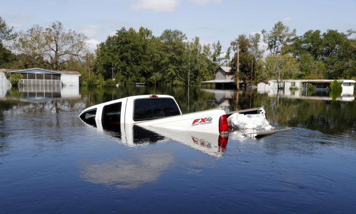 A submerged truck sits in floodwaters in the aftermath of Hurricane Florence in Nichols, S.C., Sept. 21, 2018. (AP Photo/Gerald Herbert)