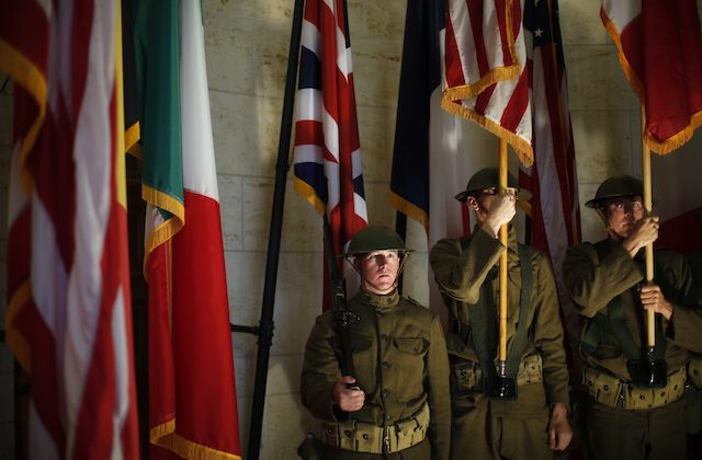 American soldiers wearing WWI military uniforms attend a remembrance ceremony in the Meuse-Argonne cemetery, northeastern France, on Sept. 23, 2018. (AP Photo/Thibault Camus)