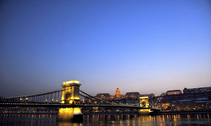 Hungary's oldest bridge, the Chain Bridge (Lanchid), over the Danube River in downtown Budapest. In the background stands the Buda Palace. (Attila Kisbenedek /AFP/Getty Images)
