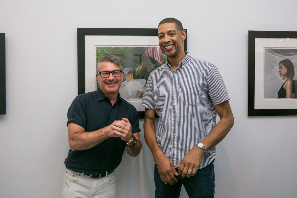 Art dealer, Frank Bernarducci and artist Mario A. Robinson pose for a photo during the opening of the exhbition of Robinson's work at the Bernarducci Gallery in the Chelsea district of New York, on September 6, 2018. (Milene Fernandez/The Epoch Times)