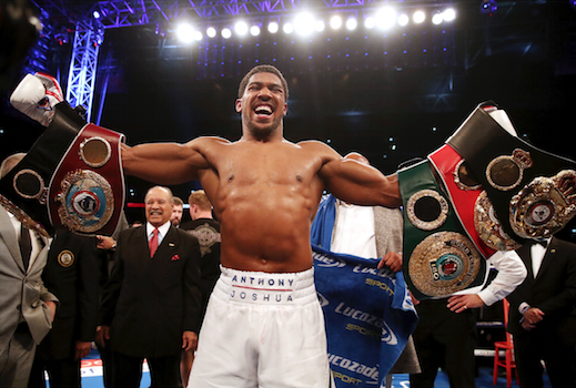 Anthony Joshua celebrates defeating Alexander Povetkin to retained his WBA, IBF, and WBO heavyweight boxing titles, on Sept. 22, 2018, at Wembley Stadium in London. (Nick Potts/PA via AP)