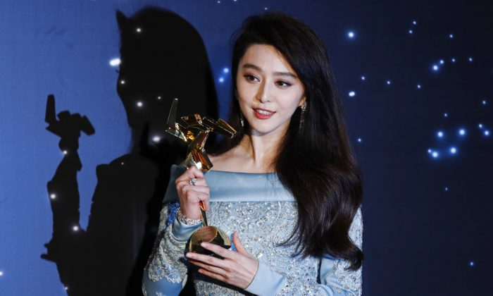 Chinese actress Fan Bingbing poses after winning the Best Actress Award of the Asian Film Awards in Hong Kong on March 21, 2017. (Kin Cheung/AP)