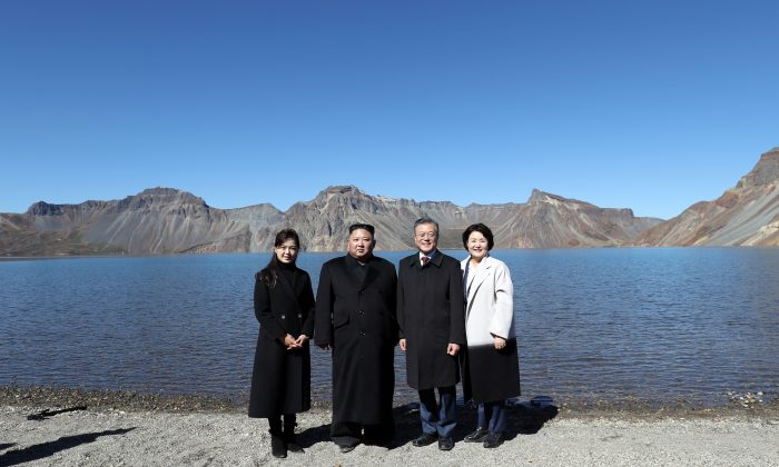 North Korean leader Kim Jong Un (2nd L) and his wife Ri Sol Ju (L) pose with South Korean President Moon Jae-in (2nd R) and his wife Kim Jung-sook (R) on the top of Mount Paektu on Sept. 20, 2018. Kim and Moon met for Inter-Korean summit talks, where they discussed ways to denuclearize the Korean Peninsula. (Pyeongyang Press Corps/Pool/Getty Images)