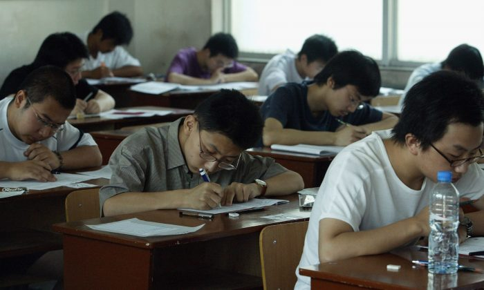 Students take part in the college entrance exam at an exam room in a middle school in Xi'an City, Shaanxi Province, China, on June 7, 2005. (China Photos/Getty Images)