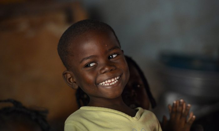 A young boy smiles at the ONO orphanage in the Mali-Maka district in the 5th arrondissement of Bangui, Central African Republic, on Jan. 6, 2014. (Miguel Medina/AFP/Getty Images)