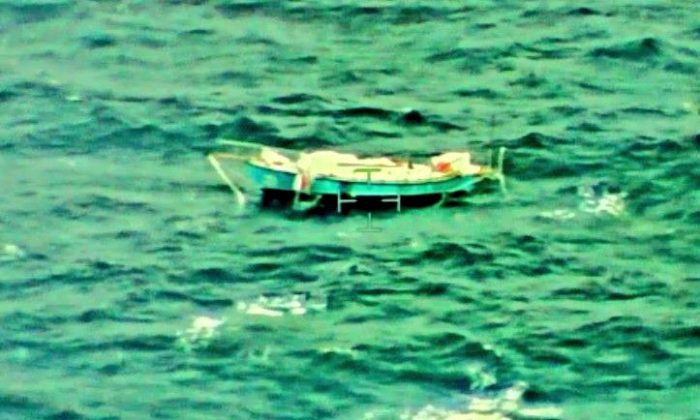 The capsized yacht Thuriya of solo sailor Abhilash Tomy is pictured at sea in this Sept. 24, 2018. (Indian Navy/Handout via Reuters)