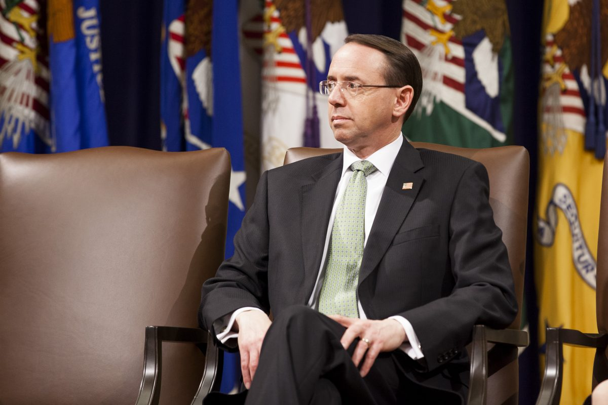 Deputy Attorney General Rod Rosenstein sits at the Department of Justice Human Trafficking Summit in Washington