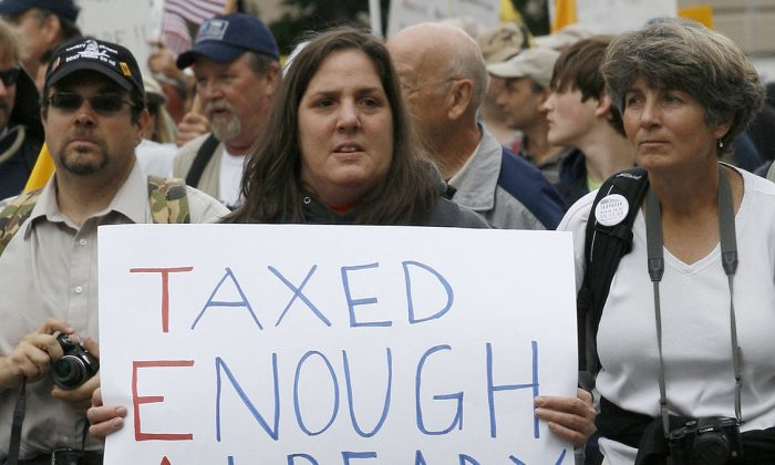 A woman holding a tea party sign at a taxpayer march in Washington on Sept. 16, 2009. (Creative Commons)